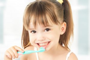 picture of a child brushing her teeth