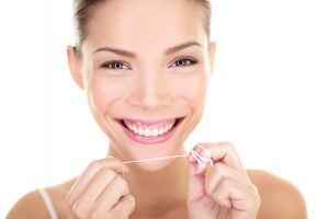 Flossing everyday helps with a great smile